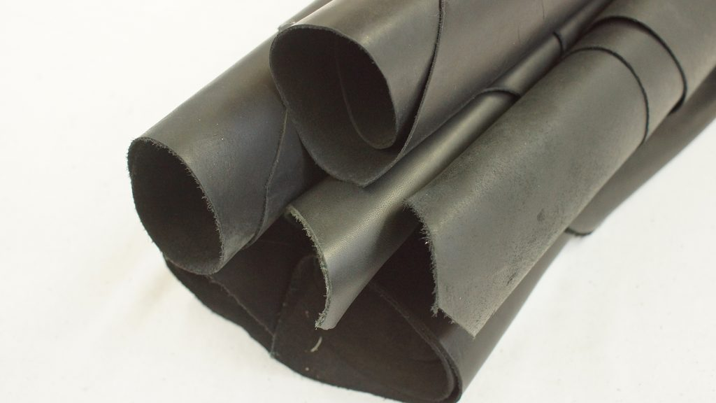 6 black leather hides